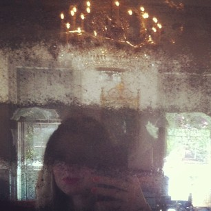 The best selfies are the ones with 18th century chandeliers, 19th century mirrors, and magenta lipstick.